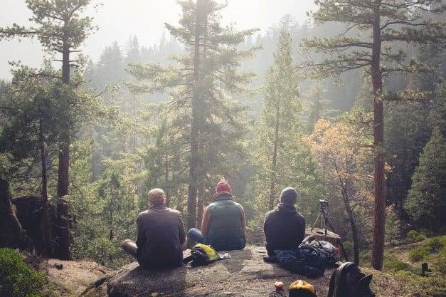 3 friends enjoying outdoor survival
