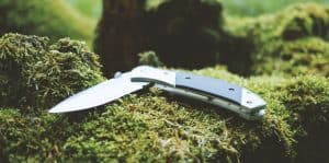 Gray and black folding survial knife